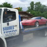 towing a sports car on flatbed
