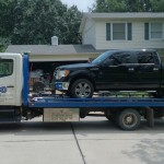 squires towing black truck